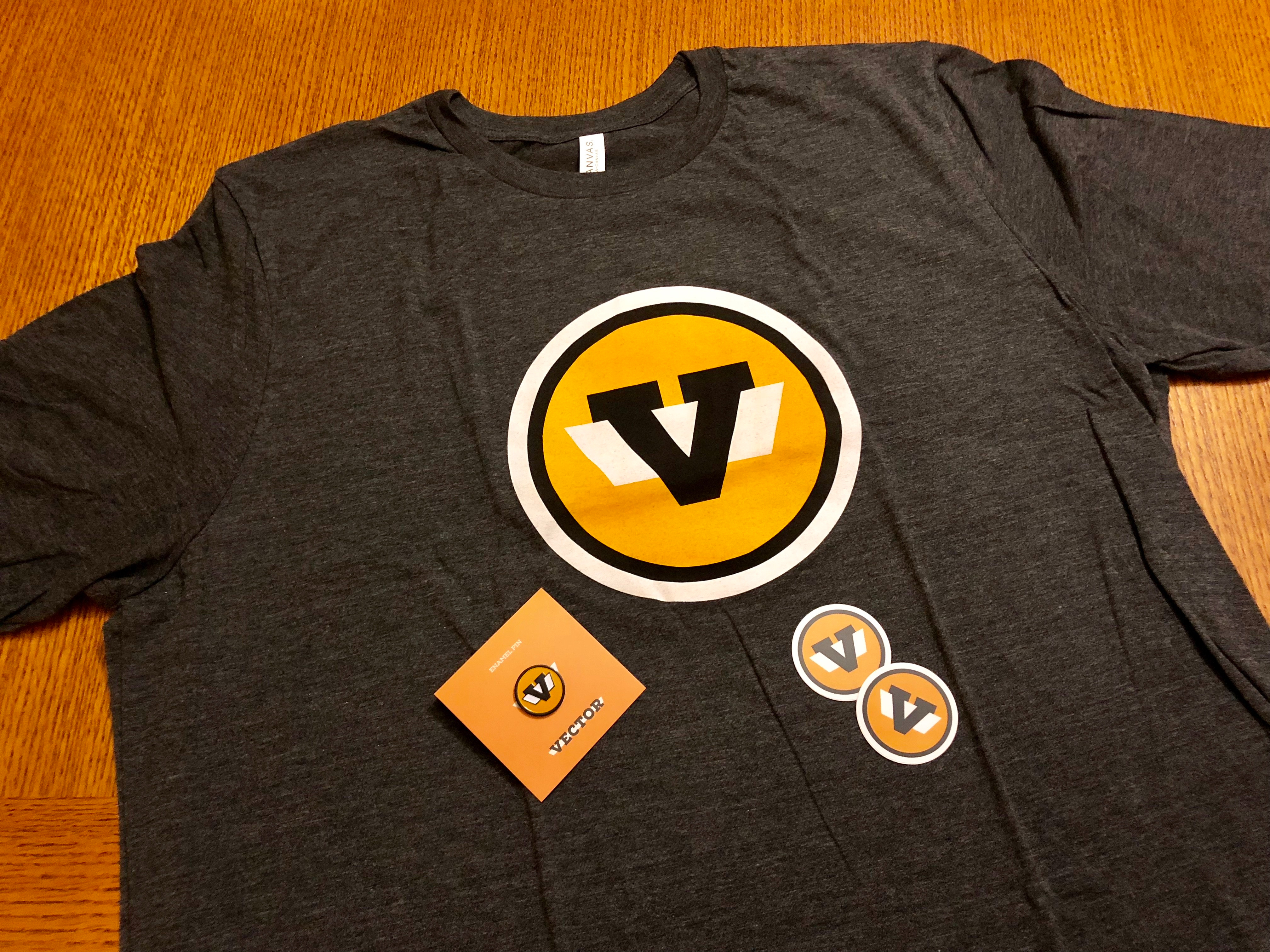 T-Shirt, pin, and stickers with Vector logo