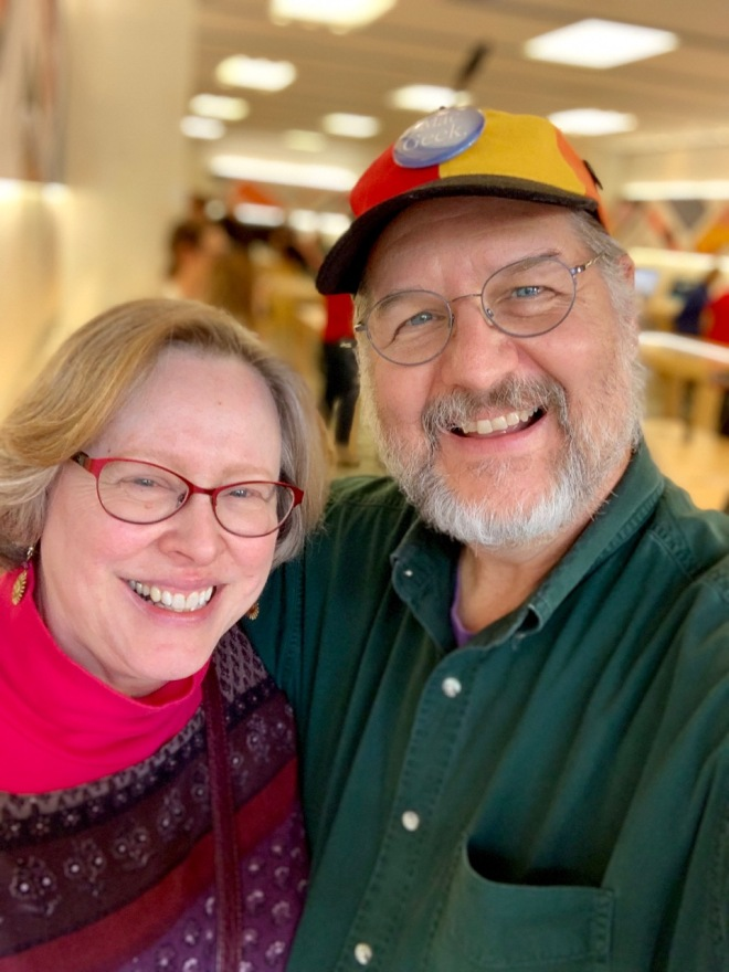 Wife and husband happy customers at Apple Retail Store