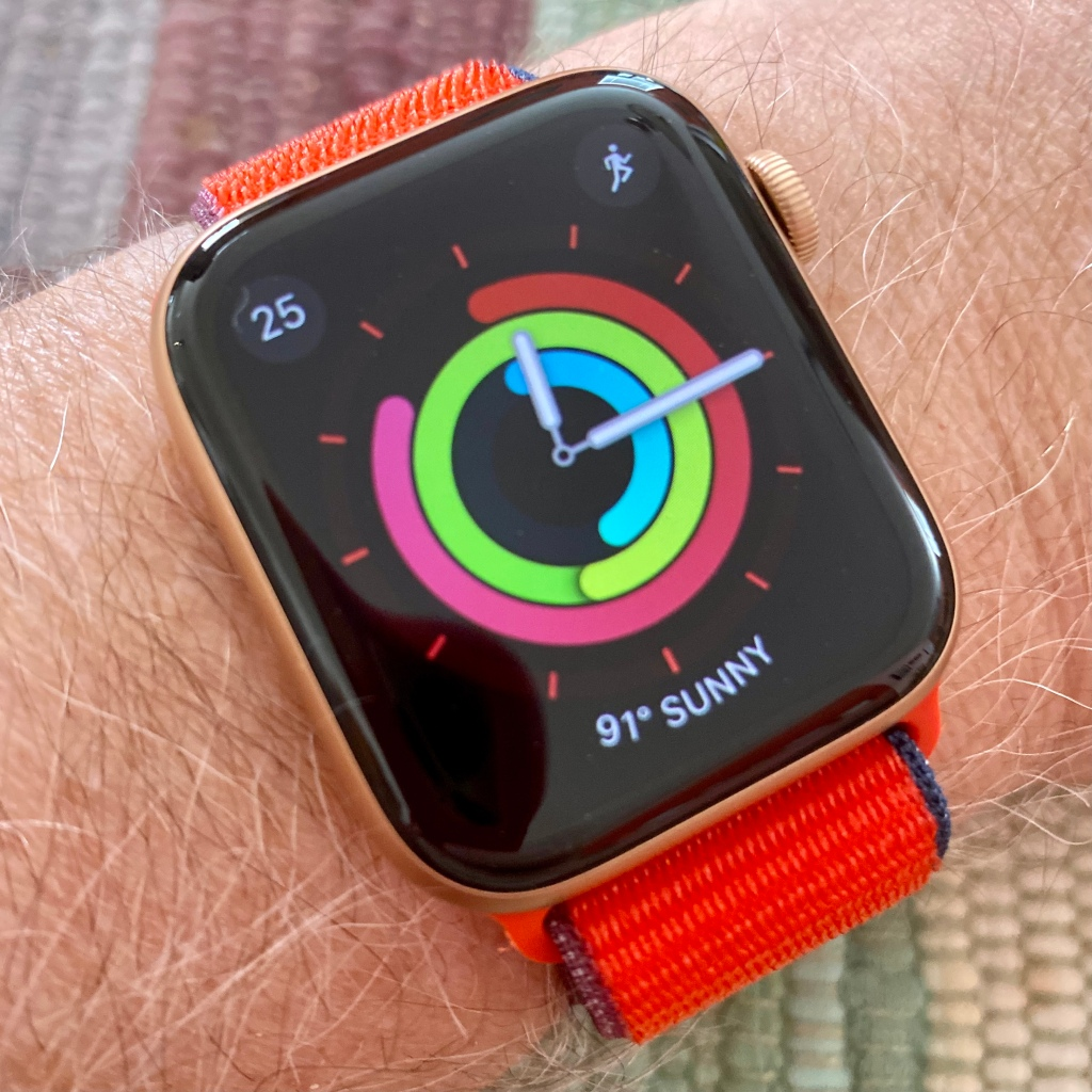 Apple Watch Series 6 gold aluminum with product red sport loop on wrist