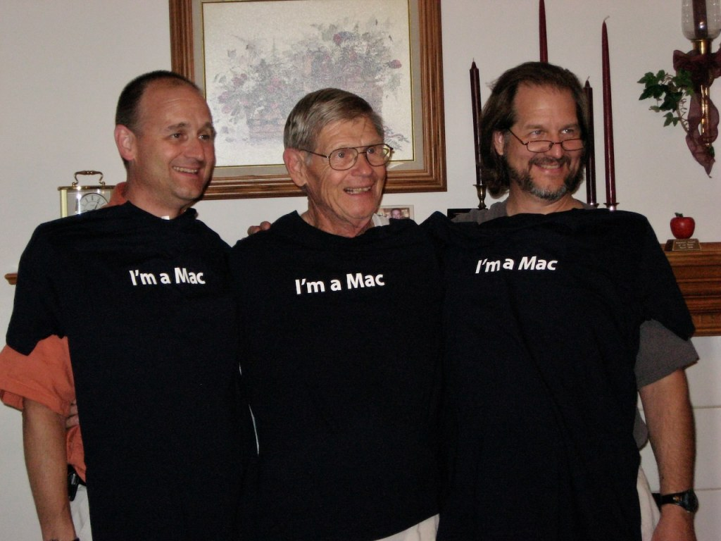 "Portrait photo of three guys with ""I'm a Mac"" T-shirts."