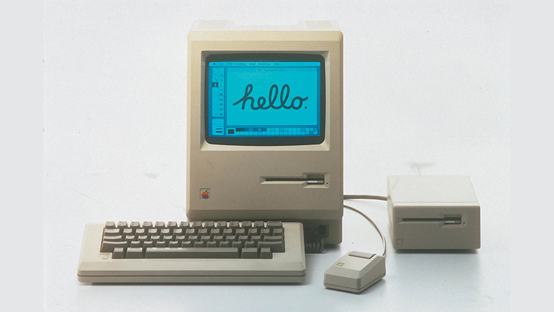 A Macintosh 128 with keyboard, mouse, and external floppy diskette drive.